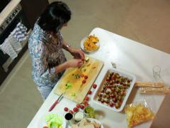 Woman preparing snacks and man helping, top view. Stock Footage