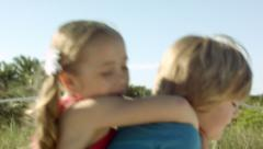 Little Girl Tries To Get Piggyback Ride From Her Brother, They Both Fall Down Stock Footage