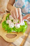 Woman is decorating stuffed eggs Stock Photos