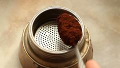 Put Coffee In Moka Pot Stock Footage