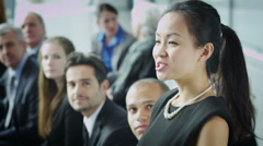 Cheerful diverse business team attend business presentation or training seminar. - stock footage