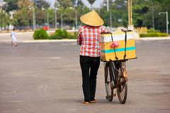 local woman selling ice cream on the street, vientiane, laos - stock photo
