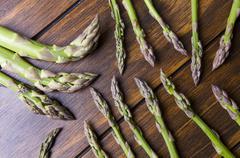 asparagus bunch on wood - stock photo