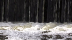 Waterfall and bubbling water on river Stock Footage