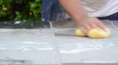 Construction man working cleaning with a yellow sponge and blue bucket Stock Footage