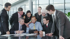 Portrait of cheerful diverse business group with a tablet computer. Stock Footage