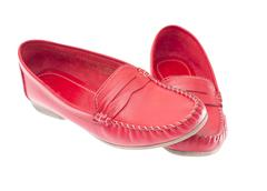 Red moccasins isolated on white background - stock photo