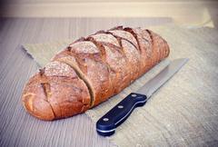Fresh Tasty Bread on Woody Background Stock Photos