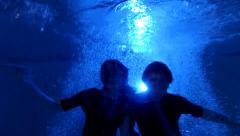 Underwater Jump In Pool At Night - stock footage