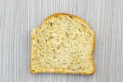 Fresh Tasty Bread on Woody Background - stock photo