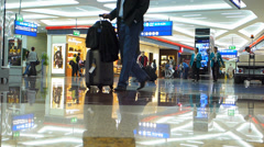 Time Lapse Dubai international Airport passengers at departure shopping area  Stock Footage