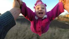 Stock Video Footage of Slow Motion. Man Rotates His Little Daughter Outdoor, First Person View From