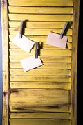 diy message board made from shutters. - stock photo
