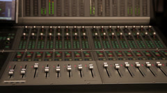 Film and TV equalizers in sound studio with audio console moving faders - stock footage