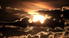 Sunrise Through Flowing Dark Clouds - timelapse Stock Footage
