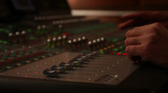 Professional sound engineer, digital mixing board, recording studio, film making - stock footage