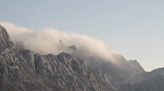 Clouds over mountain peak, Stock Footage