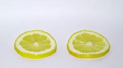 Drying  lemon slice isolated on white Stock Footage