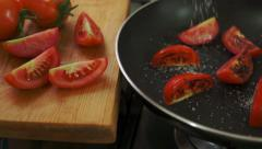Organic Tomatoes Fried with Salt and Pepper Stock Footage