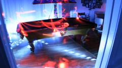 Stock Video Footage of Futuristic techno billiards table with trippy laser light show arcade.