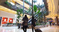 Macau Hotel Casino luxury shopping mall arcade retail China Asia Stock Footage