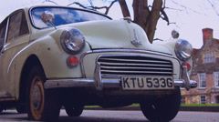 Retro style 1970's English film (Morris Minor in city) Stock Footage