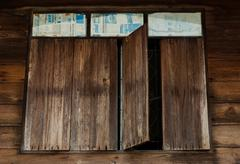 The window of the old wooden log house Stock Photos