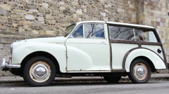Old Morris Minor with old city background Stock Footage