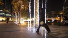 Illuminated Christmas light around Dubai Mall at night UAE Stock Footage