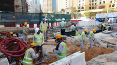 Dubai Marina foreign Indian Pakistani workers at construction Roadworks site UAE Stock Footage
