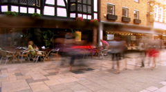Time lapse of shoppers on a commercial street in a small English town Stock Footage
