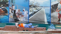 PAN Dubai Marina cheap foreign construction workers rest under promotion Stock Footage