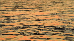 Reflection of a tropical sunset in a calm ocean Stock Footage