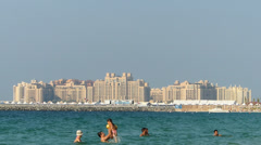 Newly built luxury houses apartment along Jumeirah overlook from Dubai Marina Stock Footage