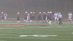 Football in fog at university stadium Stock Footage