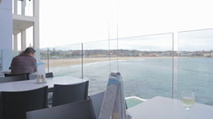 A pan from the bondi iceberg balcony overlooking the beautiful ocean Stock Footage