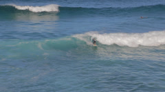 A close overhead view of a man surfing the waves at Bronte beach Stock Footage