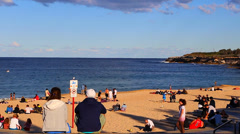 People relaxing on coogee beach on a sunny afternoon Stock Footage