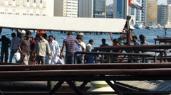 Dubai Blu Dubai Abra ferry full of foreign workers commuters crossing creek Stock Footage