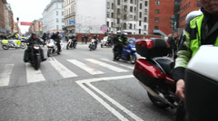 Motorcycles arriving in the city Stock Footage