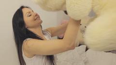 Girl and teddy-bear Stock Footage