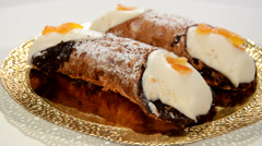An italian dessert. Sicilian cannoli rotating over white. - stock footage