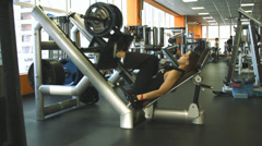 Female exercising their legs on the training Stock Footage