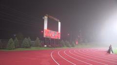 Football in fog at university stadium Stock Footage