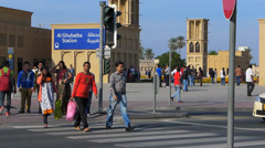 Dubai Blu Street scene commuters migrant crosswalk traffic Al Ghubaiba metro Stock Footage