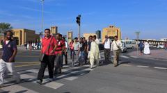 Dubai Blu Street scene migrant commuters crosswalk traffic Al Ghubaiba metro Stock Footage