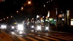 Car headlights at night Stock Footage