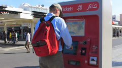 Dubai Blu Dubai tourist buy ticket at Ghubaiba bus station UAE Stock Footage