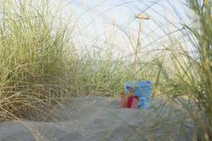 Italy, Adria, shovel and basket at beach dunes Stock Photos