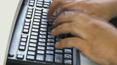Typing on the laptop keyboard Stock Footage